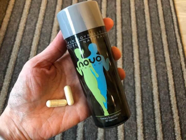 Bottle of Novo Renew and two pills in a hand