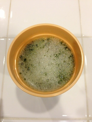 Water in cup with green powder