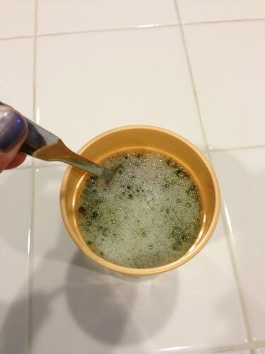 Stirring the green drink