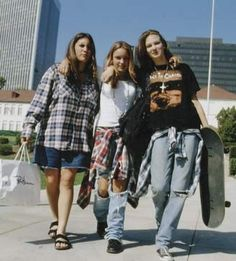Girls in baggy 90's clothing - jeans and plaid