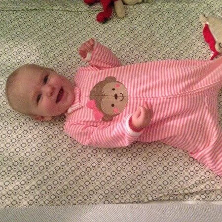 A day in my life - happy baby in her crib.