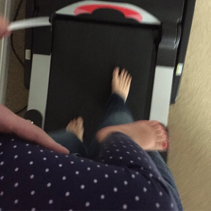 Treadmill while carrying a kid.
