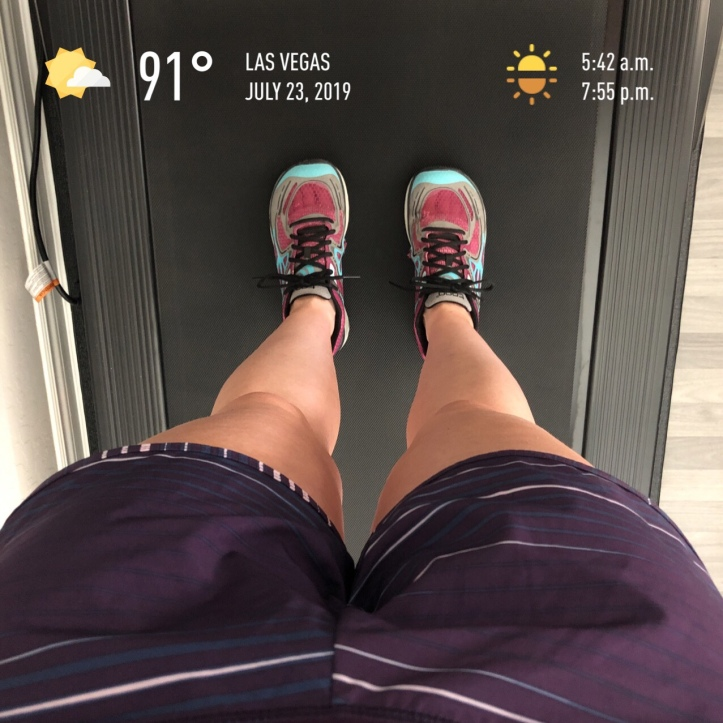 Feet in running shoes on a treadmill
